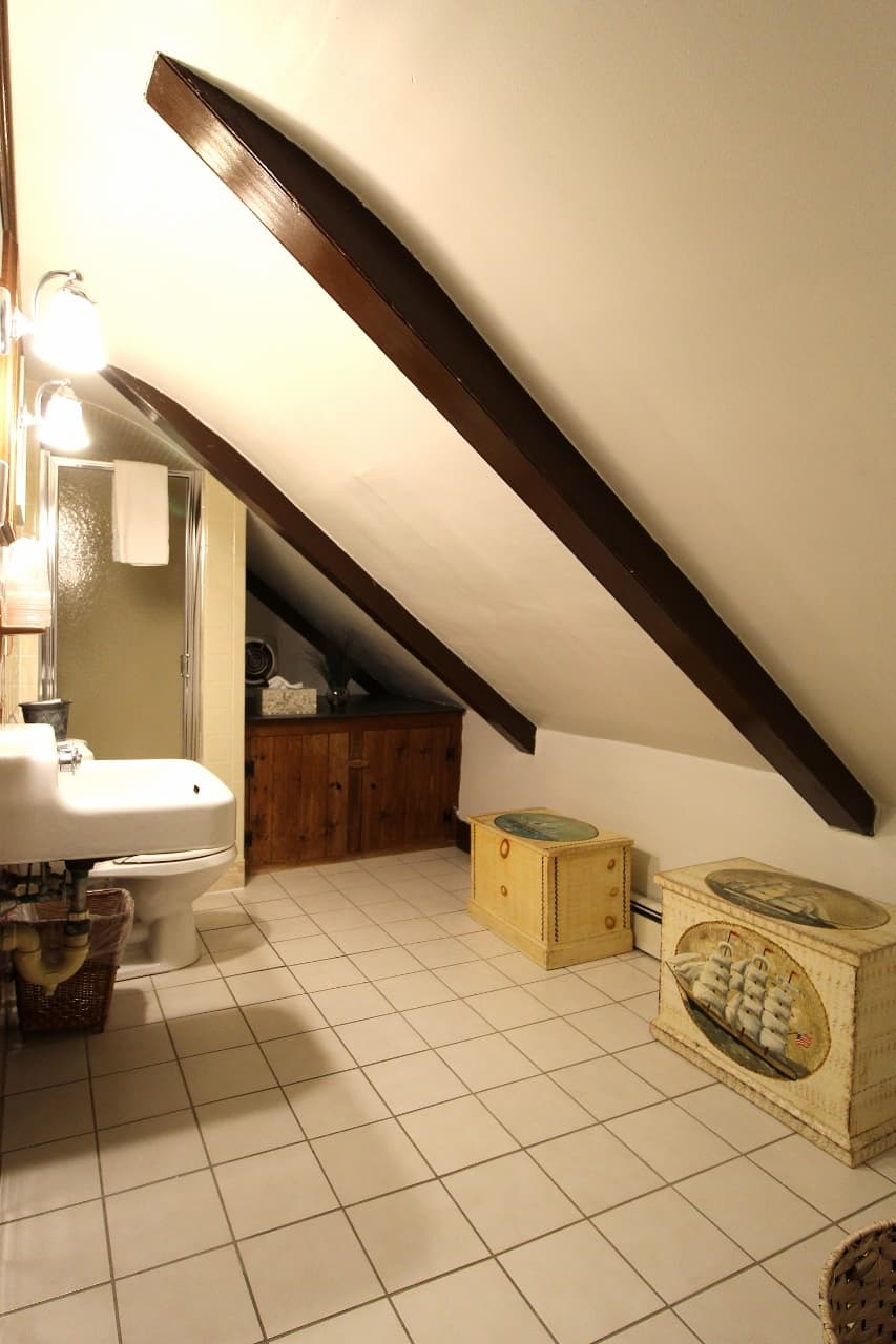 Bathroom with slanted ceiling for rooms 6 and 7