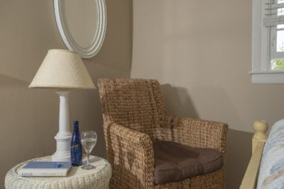 A wicker chair with a glass of wine