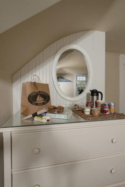Dresser in Room #6 with to-go breakfast and coffee station