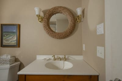 Bathroom sink and round sailors knot mirror