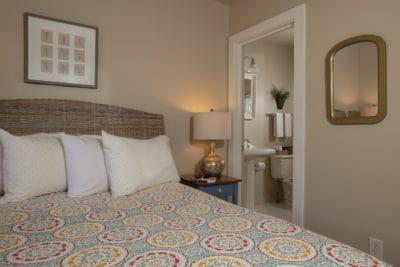 The en-suite bathroom is next to the bed in this petite queen room #12