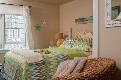 Room 9 green bedspread and queen bed