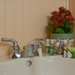 King room 16 sink with bath amenities and flowers