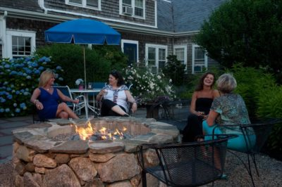 Guests enjoy the firepit at our Cape Cod hotel
