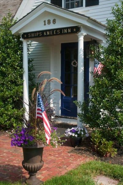 A USA flag in a flowerpot greets guests at our bed and breakfast