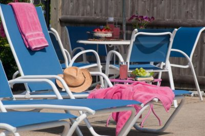 Pool loungers with towels and sunhat