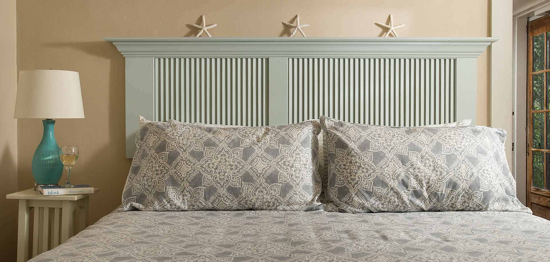 King room bed with starfish decor and headboard
