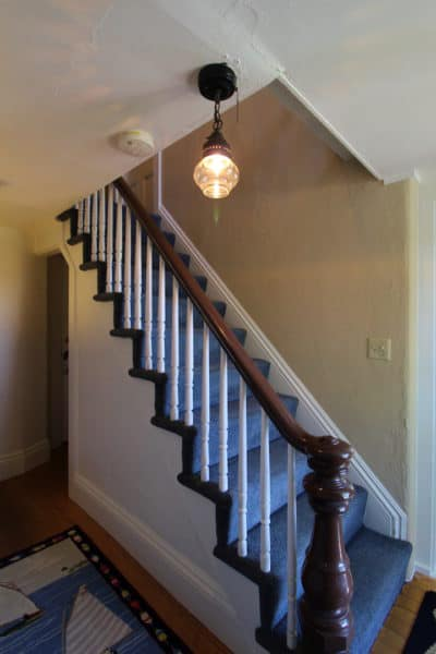 The stairs to the second floor rooms
