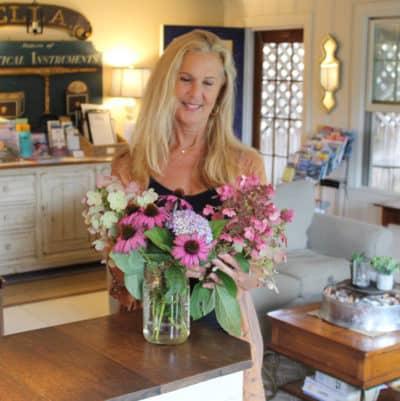 Denise arranges fresh flowers