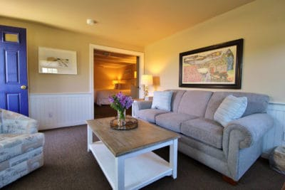 The nauset Suite sitting area with couch and TV